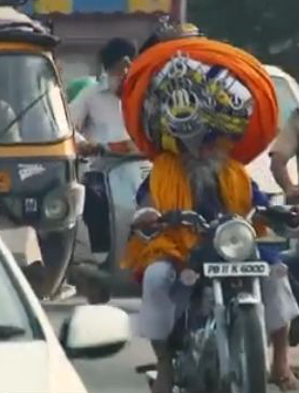 Here's one turban that probably protects as well as a DOT lid.