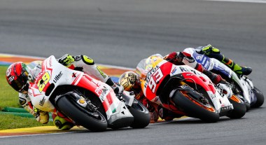 """Iannone, Rossi and Marquez locked in battle. Rossi joked that his bad luck was named """"Marc Marquez,"""" but at least he hung on to second place in the race, and overall."""