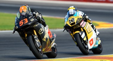 Rabat leads Luthi in Moto2 action; at the race's end, it looked like Rabat screwed up by doing his victory wheelie prematurely, allowing Luthi past.