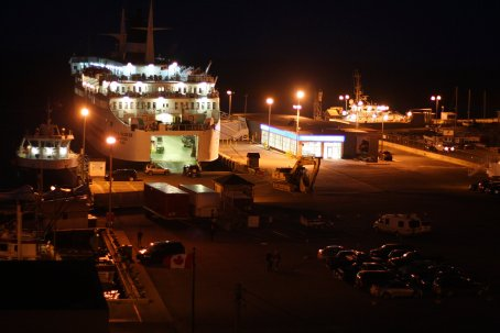 The ferry unloads its hold after a nighttime crossing.