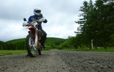 Dual sport riding through the Cape Breton Highlands - shivering and soggy, due to my missing jacket, but pleased with the pants' performance.