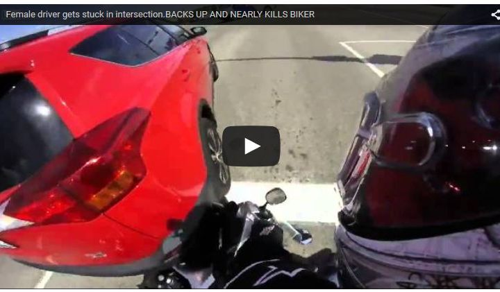 Video: Edmonton motorcyclist nearly crushed by driver