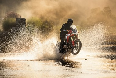 Once again, Honda emphasizes the bike's offroad capability.