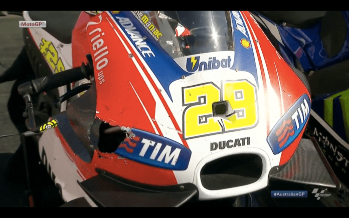 Hole punch. Andrea Iannone's Ducati shows the severity of the damage to it's carbon fibre fairing