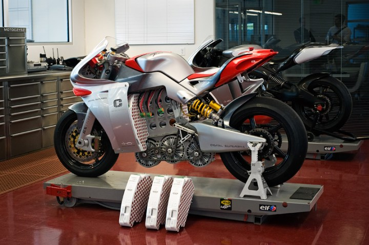 The 2009 Motoczysz E1PC electric racing bike debuted at the Isle of Man. Scratch-built in months, it was itself based on the stillborn but also scratch-built Motoczysz MotoGP prototype.