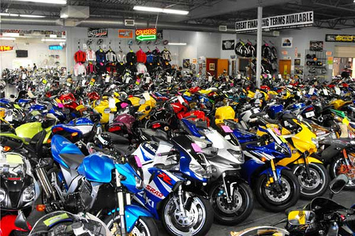 A new Kawasaki, Suzuki, Honda, Yamaha and Triumph in the first row.
