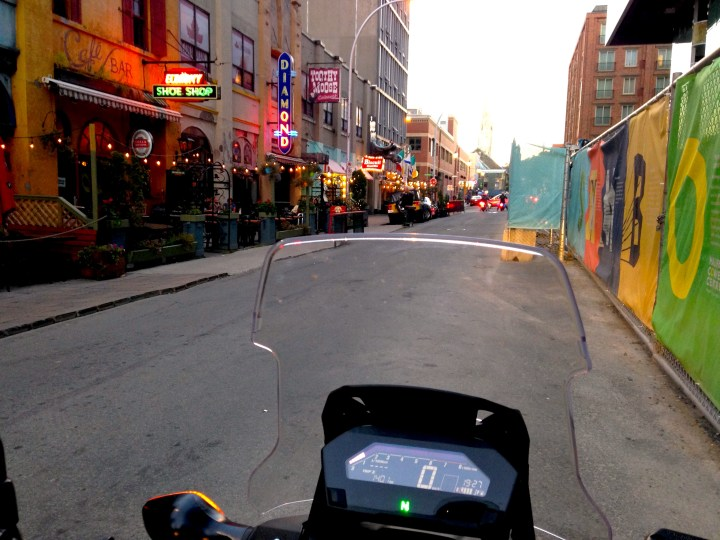 NC750X in its natural habitat: a street lined with bars, in this case Argyle Street in Halifax.