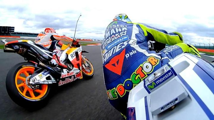 Rossi an Marquez trade paint.