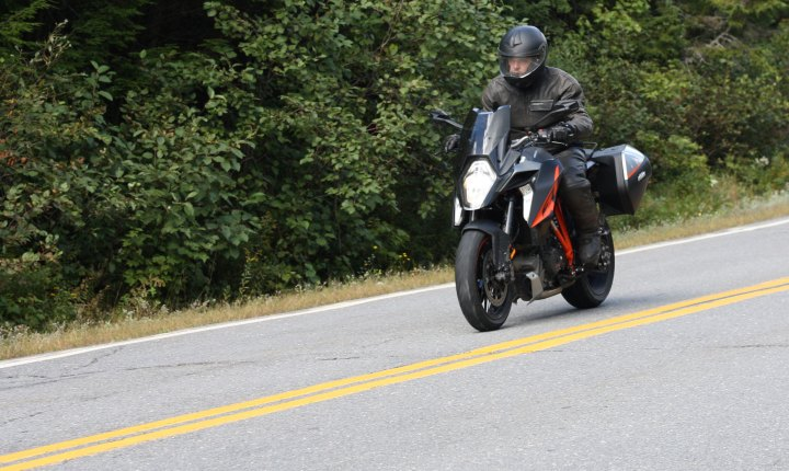 Heated grips, adjustable windshield, and hard bags are the bare minimum needed for touring comfort, but stripping the GT to the basics means it retains its naked bike essence.