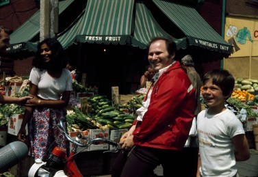Photo: Al Waxman on location at Kensington Market, Toronto Photography Date: May 1975 Originals are housed at Library and Archives Canada ..
