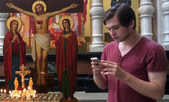 [A still from Ruslan Sokolovsky's video, showing him playing Pokémon Go in a Russian church.]