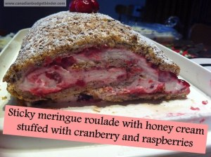 Sticky meringue roulade with honey cream stuffed with cranberry and raspberries