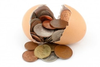 building wealth egg and coins