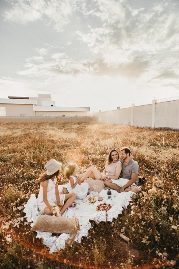 Family picnic outside on blanket
