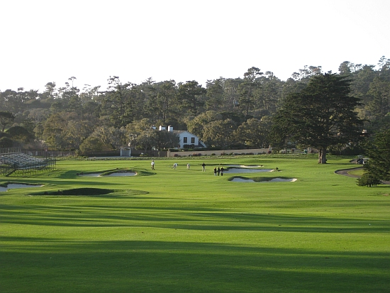 Inland: The 15th at Pebble Beach, with 17-mile Dr. on the right.