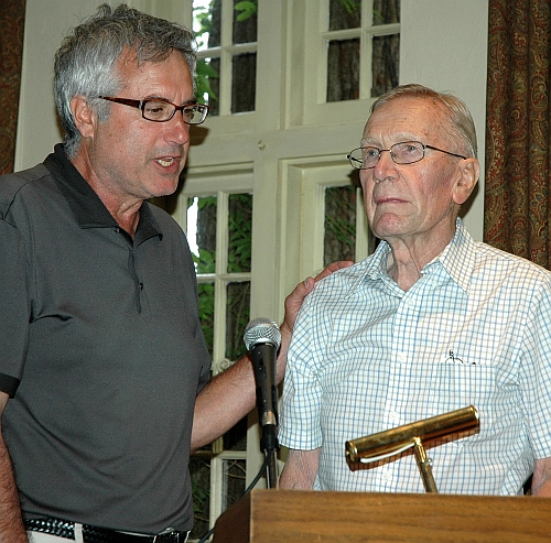 Lorne Rubenstein presents historican Jim Barclay with a lifetime membership to the GJAC yesterday at St. George's in Toronto.