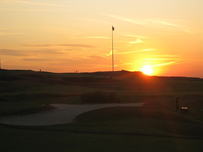 Stunning: A great sunset for a great day at the finishing hole at National Golf Links of Amerca.