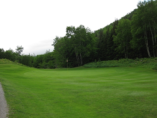 The 9th at Highlands Links with fewer trees and more grass on its green.