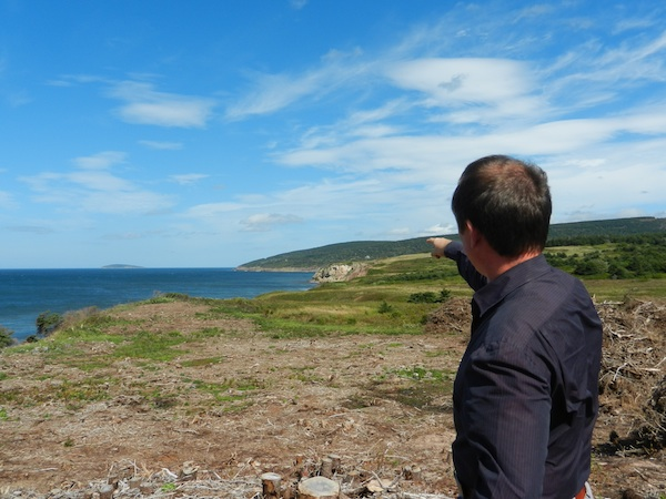 Cabot Links managing director Ben Cowan-Dewar points to the cliffs where designer Bill Coore has proposed a remarkable par three.