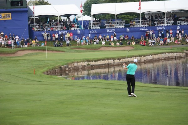 Brandt Snedeker fires into the 18th green at Glen Abbey yesterday.