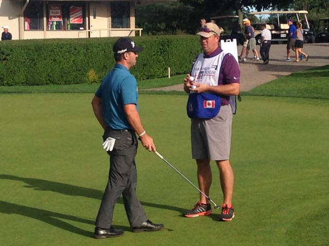 Before the playoff: Talking strategy before hopping on the back of a cart and heading to 18 tee.