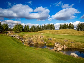 The split fairway par-4 17th features a well landscaped waterfall that protects the green