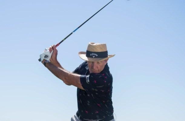 Golf instructor David Leadbetter swinging a golf club