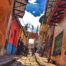 This pictures sums up a lot of Bogota for me so far. The vibrant streets are impossible to not be influenced by. I think of walking through the grey, cement-filled city of Los Angeles. This is in the Candelaria district of the city. Every little cobblestone alley tells a story with each step.