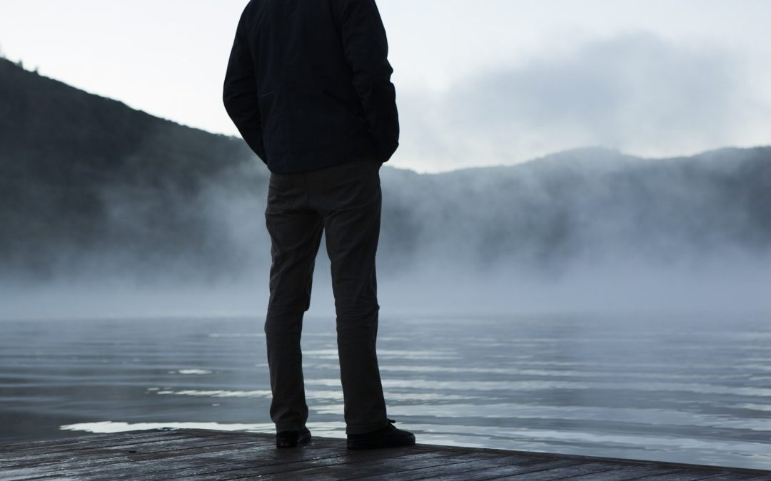 A man looking out onto the water