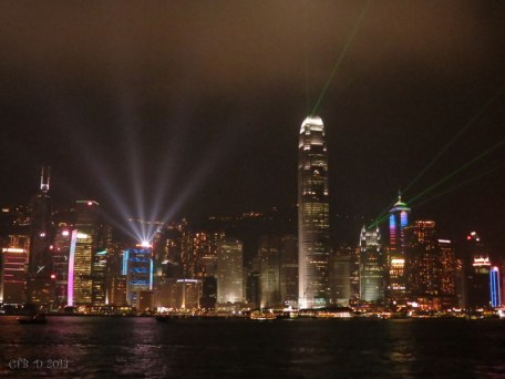 Victoria Harbour lit up at night.
