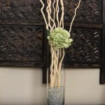 como decorar una pared con ramas secas