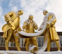 The gilded bronze statue of Matthew Boulton, James Watt and William Murdoch in Centenary Square.