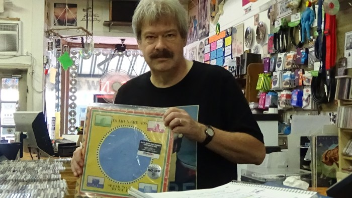 TS ME owner, Geoff Dwyer, holding his favorite Talking Heads album, Speaking in Tongues