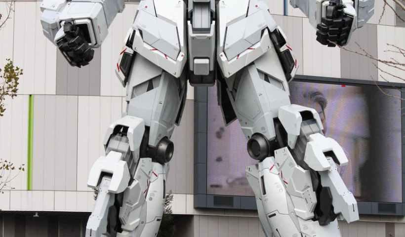 gray robot statue near building