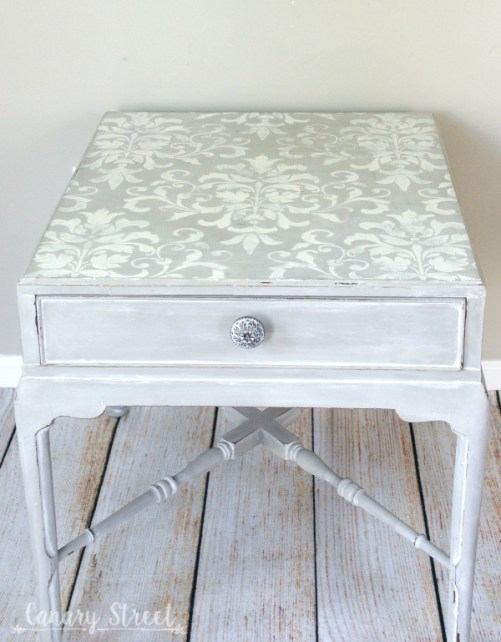 Gray table with white wash and stenciled top.  https://canarystreetcrafts.com/