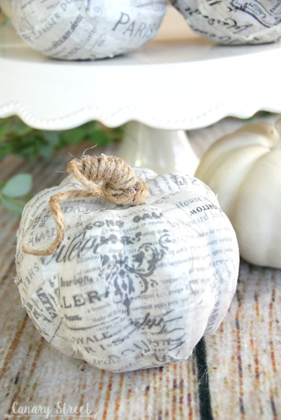 Easy way to update faux pumpkins! Use Mod Podge to cover faux pumpkins with any fabric or paper. Wrap twine around the stem. https://canarystreetcrafts.com/