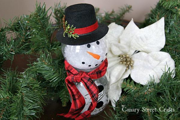 DIY Mason Jar Snowman. Made using a mason jar and a clear ornament! {Canary Street Crafts}