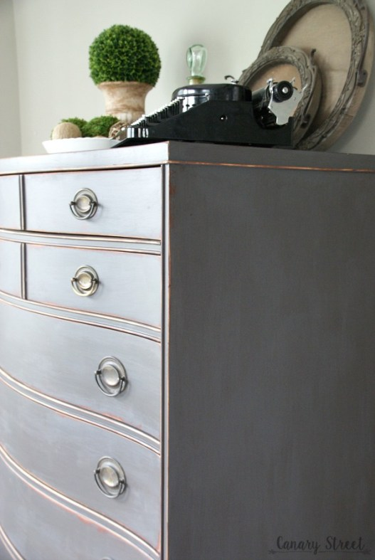 Gorgeous weathered gray dresser. Lots of furniture makeovers and painting tips on this site! https://canarystreetcrafts.com/