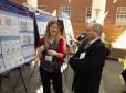Trainee Meagan Ryan presenting her poster to Speaker Paul Kirshmeier, PhD