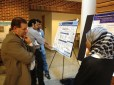 Aminah Wali Presenting a poster; Ricky Antonia presenting a poster in backgroud