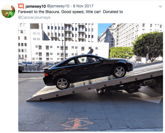 picture of donated car being uploaded on flatbed truck