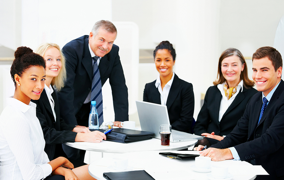 group of people in business attire in a meeting