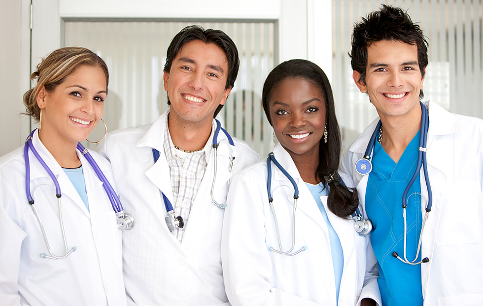 group of diverse doctors smiling