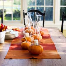 pumpkin candles in glass candle holder
