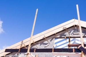 The wooden frame hasd been designed to made a molding at the top of the roof line to nicely finish off the new wall.