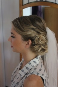 Side view of Bridal hair and makeup