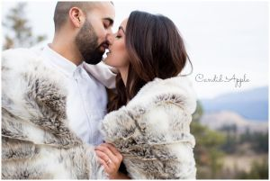 Couple snuggled up under a blanket about to kiss