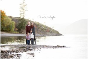 A family standing on the lakeshore during Fall