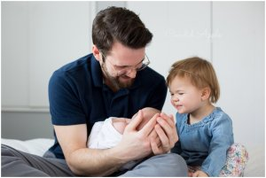 A family during their lifestyle newborn session