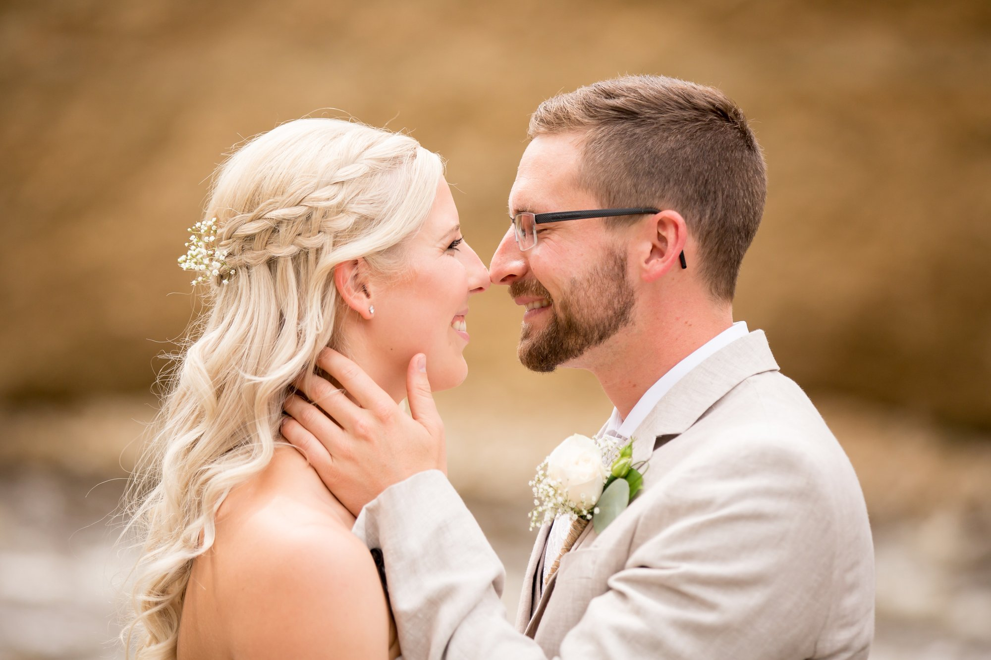 A bride and groom touching noses together